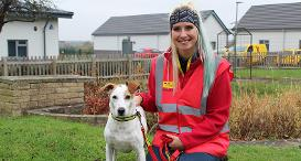 Dogs Trust Volunteer with a dog