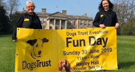 Staff at Dogs Trust Evesham holding a Fun Day banner.