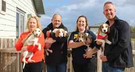 Three recent winners of People's Postcode Lottery visit Dogs Trust Evesham